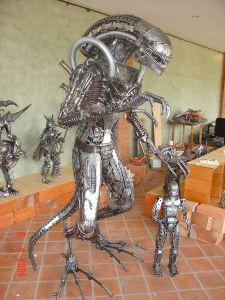 alien statue scrap metal
