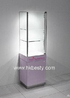 Three Glass Shelves With Glass Door With Wooden Frame Used In