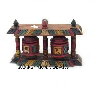 wooden sculpture prayer wheels