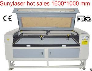 High Efficiency Double Heads Laser Cutting Machine For Fabrics Leathers Clothes Etc
