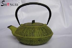antiquated green cast iron tea pot