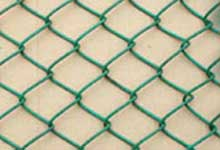 chain link fence airport sport field highway building garden
