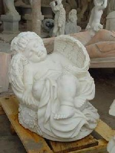 sleeping angele statue