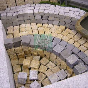 tumbling stone granite cubic building