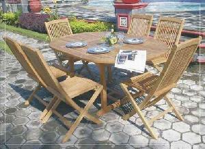 folding oval ext table teak