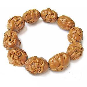 wooden buddha head wrist mala