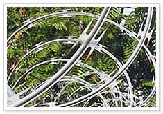 concertina razor wire barbed farm field grassland military base prison