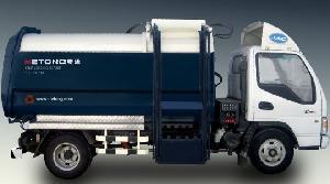 dumping refuse transfer truck