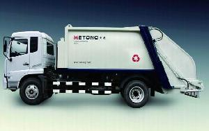 refuse compactor garbage compressing truck