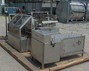 intermittent motion tray former packer