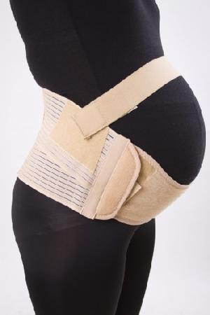 Maternity belly band in color Creme Brulee (light cream) in size 1 (see chart). Brand new in package. Package is not completely smooth but item is completely intact and brand new.