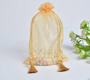 golden organza gift drawstring bag tassels